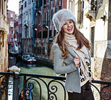 happy tourist woman in Venice, Italy in winter having excursion