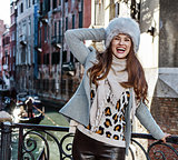 traveller woman in Venice, Italy in winter enjoying promenade