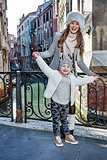 mother and daughter tourists in Venice having fun time