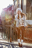 smiling woman in Venice, Italy in winter speaking on cell phone