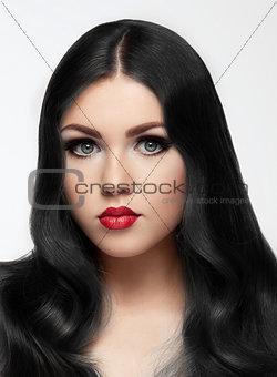 Beauty brunette model with long hair and red lips