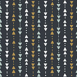 Seamless hand drawn geometric tribal pattern with triangles and dots. Vector navajo design.