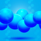 Glass blue spheres over blue background