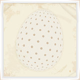 Withe decorated Easter egg over vintage paper background