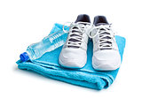 sport concept. bottle, shoes and towel