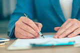 Businesswoman signing business contract agreement