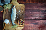 Fresh fish smelt spices for cooking on a kitchen board