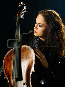 Cello player and her instrument
