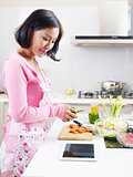 asian housewife preparing meal in kitchen
