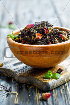 Flavored black tea with flower petals.