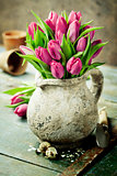 Pink tulips bouquet, easter eggs and garden tools