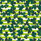 Shamrock green striped trefoil leaf seamless vector pattern.