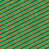 Diagonal red and green line pattern with glitter.