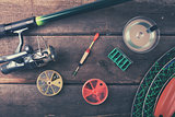 fishing equipment on old wooden table. top view