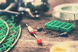 closeup of fishing tackle on wood table