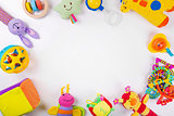 colorful baby toys on white with copy space
