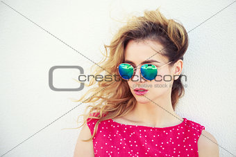 Portrait of Beautiful Fashion Woman in Sunglasses