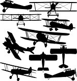 Silhouettes of old aeroplane - contours of biplanes