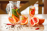 grapefruit mint lemonade on table with pepper and chili