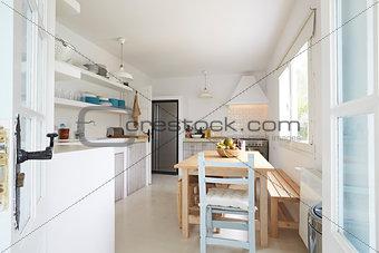 Modern Kitchen Viewed Through Open French Windows