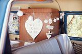 View through window of decorated retro camper van interior
