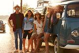 Friends in a camper van make a roadside stop, full length