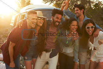Group shot of friends on a road trip posing together
