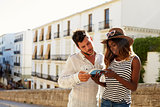 Young couple reading a guidebook, waist up, Ibiza, Spain