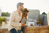 Young adult couple sightseeing in Ibiza, Spain, side view