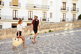 Couple on holiday walking in the street holding hands, Ibiza