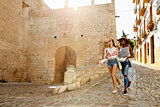 Two female friends on holiday walking with guidebook, Ibiza