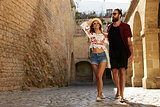Couple sightseeing old buildings on vacation, Ibiza, Spain