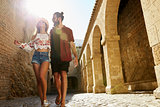 Couple sightseeing on vacation, lens flare, Ibiza, Spain