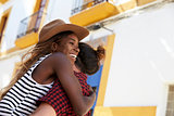 Happy couple embracing in the street, close up, Ibiza, Spain