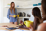 Three female friends drinking coffee in the kitchen, Ibiza