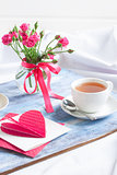 Morning Valentine's breakfast on blue wooden tray