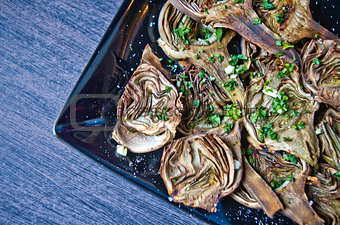 artichokes baked with oil, parsley and lemon