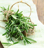 Fresh organic rosemary on a wooden table
