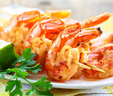 fried shrimp on skewers with herbs and spices