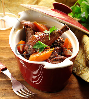 slow stew the cock in red wine with vegetables