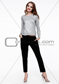 Beautiful fashion model wearing silver top