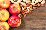 Nuts and red apples