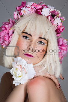 Beautiful girl with floral head accessory