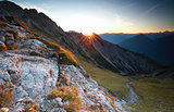 sunrise over rock in Alps