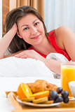 Vertical portrait of a brunette in bed and breakfast