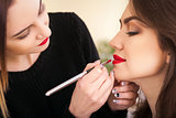make-up artist doing make-up girl in the salon, beauty concept