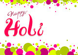 Happy Holi greeting card. Colored confetti and lettering text