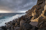 Terceira island coastline with stairs and waves breaking, long exposure