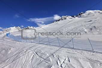 Ski track in sun winter day