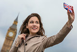 Woman Tourist Taking Selfie by Big Ben, London, England